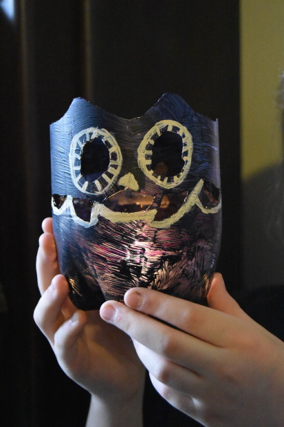 Photo of a DIY owl lamp made out of a plastic bottle.