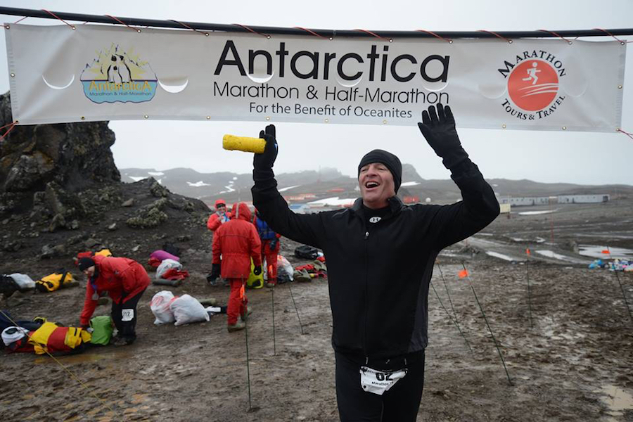 Photo of Mike Messerschmidt running in a marathon in Antarctica.