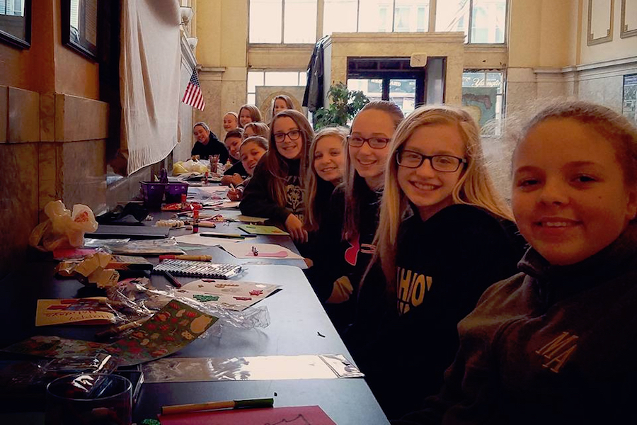 Photo of holiday cheer being made by the Mahanoy Area Midget Cheerleaders.