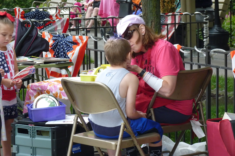 Photo of a child participating in face painting during Mahanoy City's Community Day event.