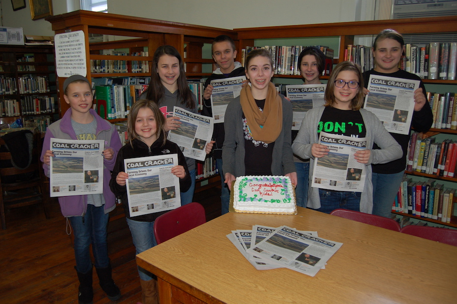 Photo of the Coal Cracker staff celebrating publication of the first issue.