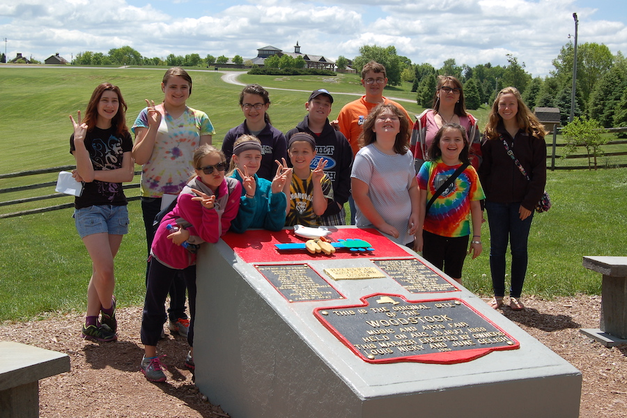 Photo of Coal Cracker and Manor Ink journalists at the original Woodstock site.