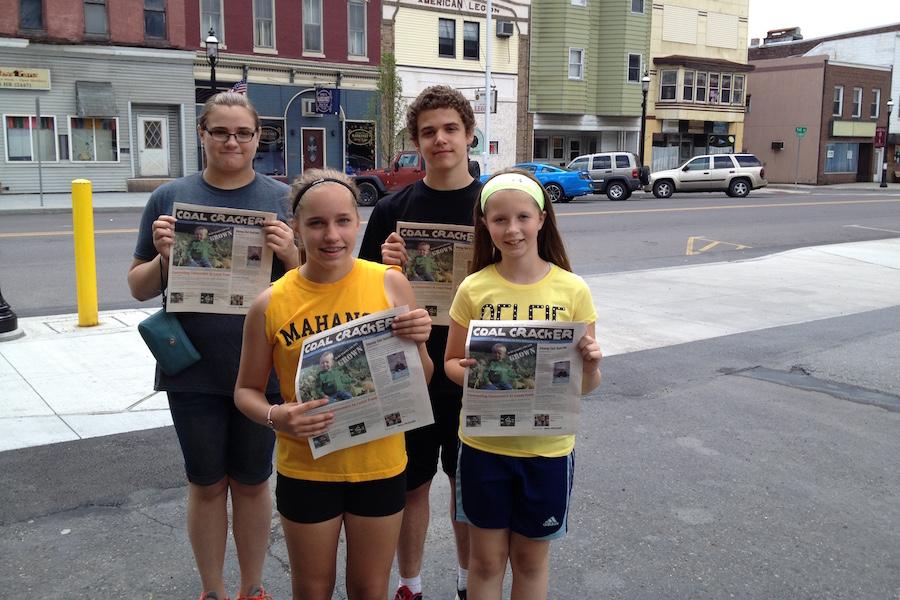 Photo of newspaper distribution.