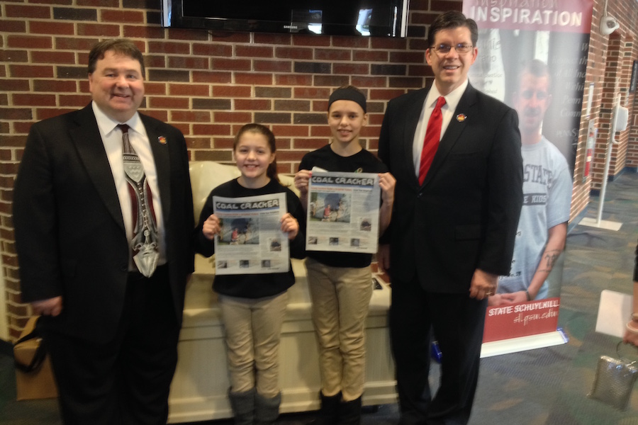 Photo of Schuylkill County Commissioners and Coal Cracker Kids reporters at the 2015 youth summit.